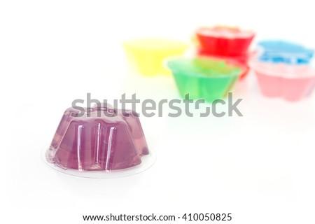 purple gelatin dessert on white background - stock photo