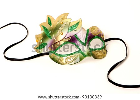 Purple, Gold, and Green Venetian Mask with Black Ribbon on White - stock photo