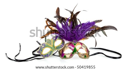 Purple, green and gold mardi gras masks on a white background - stock photo