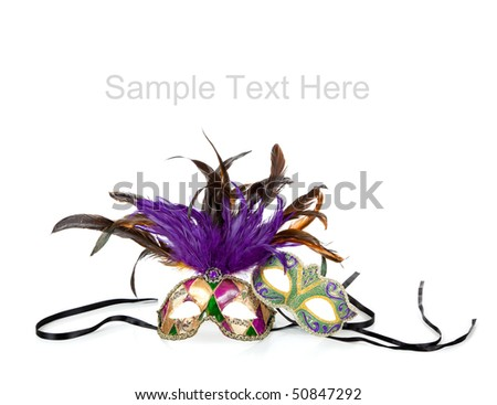 Purple, green and gold mardi gras masks on a white background with copy space - stock photo
