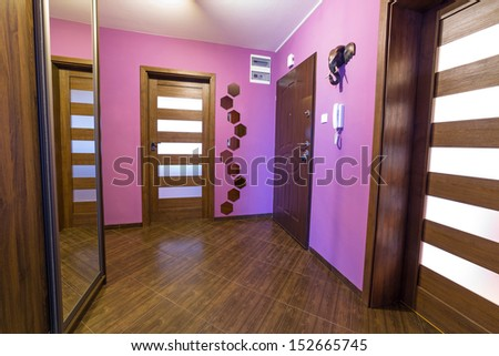 Purple hall interior with brown tiles