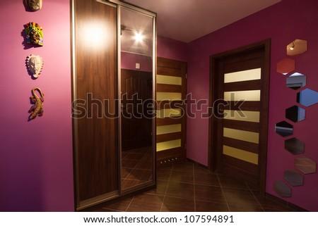Purple hall interior with wardrobe - stock photo