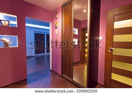 Purple hall with wardrobe interior - stock photo