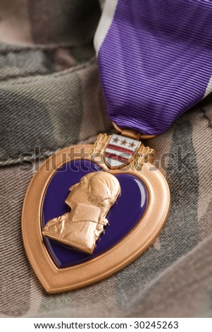 Purple Heart War Medal on Camouflage Material - stock photo