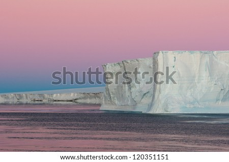 Purple hour in Antarctica - stock photo
