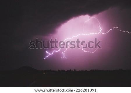 Purple lightning - stock photo