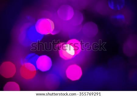 purple lights on a dark background - stock photo