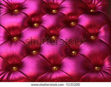 Purple luxurious chair background with golden pins - stock photo