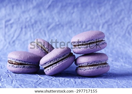 Purple macarons on paper background