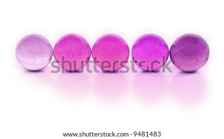 Purple Marbles in a Row - stock photo