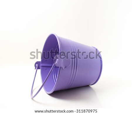 Purple metal bucket isolated on a white background