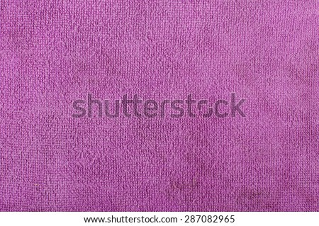 Purple microfiber cleaning cloth abstract surface pattern - stock photo