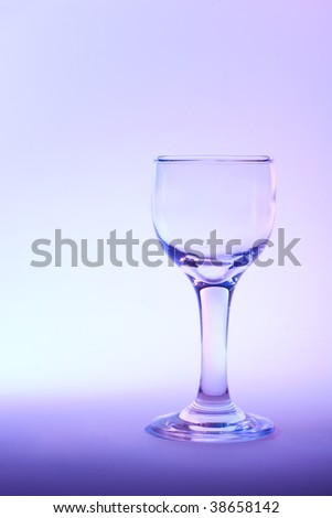 Purple moment - wine glass in beautiful purple light - stock photo