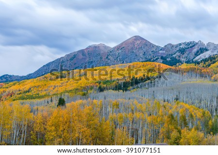 Purple Mountains at Dusk - A cloudy autumn evening view of colorful peaks of Rube Range, seen from Kebler Pass, near the town of Crested Butte, Colorado, USA. Mount Owen, 13,058 ft (3,980 m). - stock photo