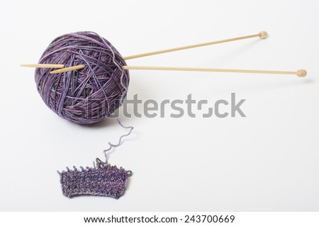 purple multicolor clew woolen yarn with needle - stock photo