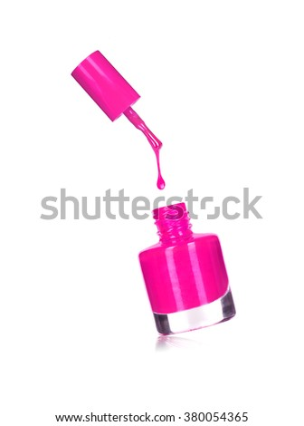 purple nail polish bottle with splash isolated on white - stock photo