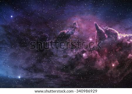 purple nebula and cosmic dust in star field - stock photo