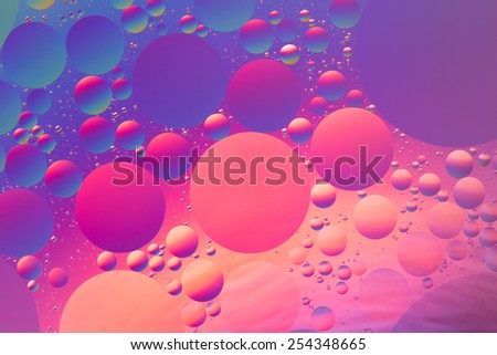 Purple, orange, red and blue psychedelic oil and water abstract, unfocused - stock photo