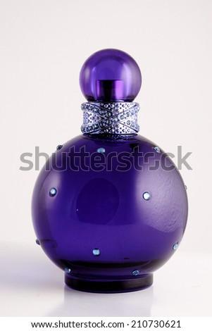 Purple perfume bottle - stock photo