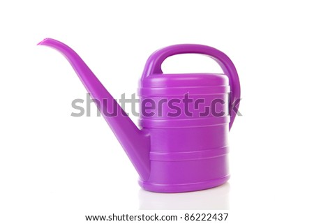 purple plastic watering can isolated on white background