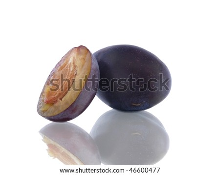 Purple plums isolated on white