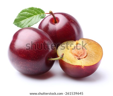 Purple plums with leaf - stock photo
