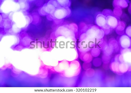 Purple ray bokeh glitter defocused lights abstract background