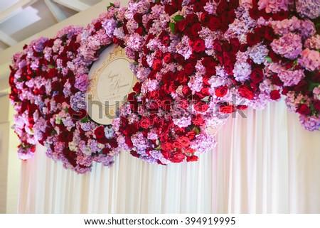 Purple & red flowers wedding reception garland decoration - stock photo
