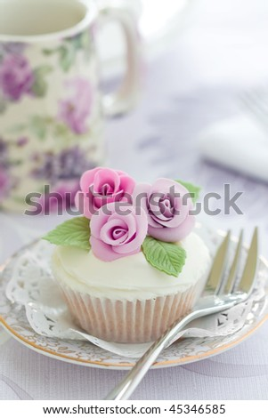 Purple rose cupcake - stock photo