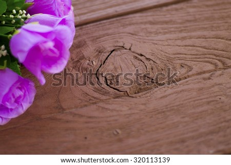Purple rose soft focus on the brown wooden. background. - stock photo