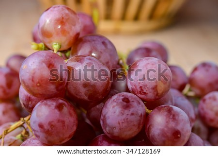 purple round grapes on old wooden table