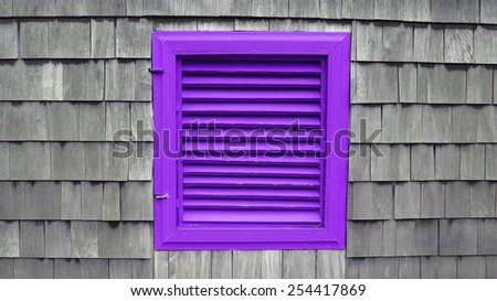 Purple rustic wooden blinds on a weathered shingle wall.                             - stock photo