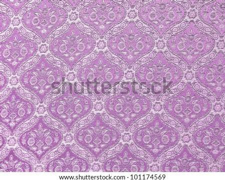 Purple seamless Thailand pattern on fabric - stock photo