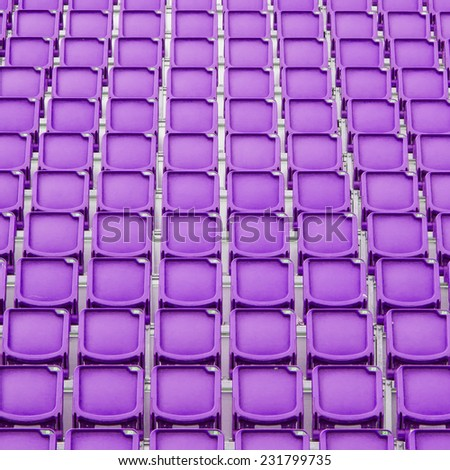 Purple seat in sport stadium, empty seats ready for the public - stock photo