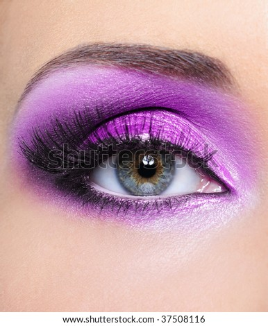 Purple shine make-up of woman eye - front view - stock photo