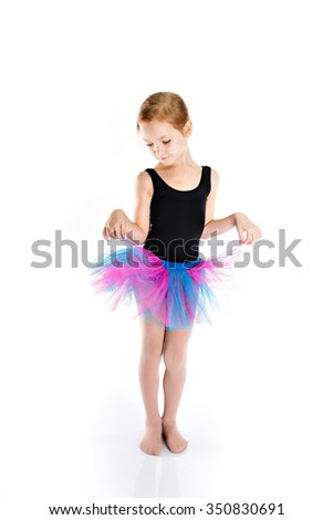 Purple skirt. Little girl isolated on white background. Funny little girl studying dance. Sport swimsuit.  Adorable little girl jumping in the air.
