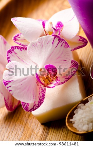 Purple spa background with few orchid flowers