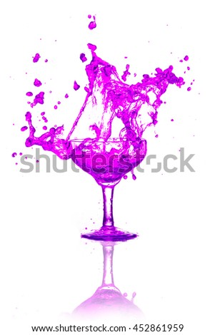 Purple splash out drink from glass on a white background. - stock photo
