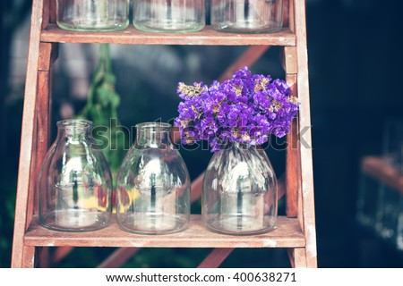 purple statice flower in small bottle with color effect - stock photo