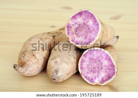 purple sweet potato and sample cut display at market place  - stock photo