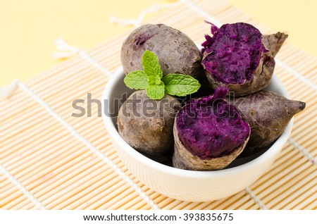 Purple sweet potatoes (healthy food) in white bowl