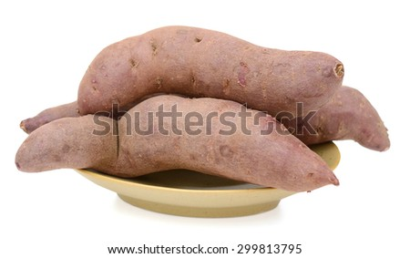 purple sweet potatoes on plate isolated on white  - stock photo