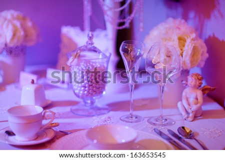 Purple table set for an event party or wedding reception