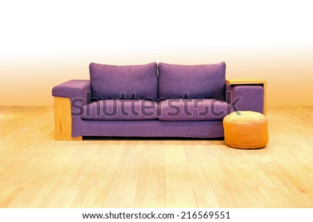 Purple textile sofa ant stool in empty room  - stock photo