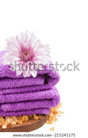 purple towels and chrysanthemum flower isolated on white background.  - stock photo