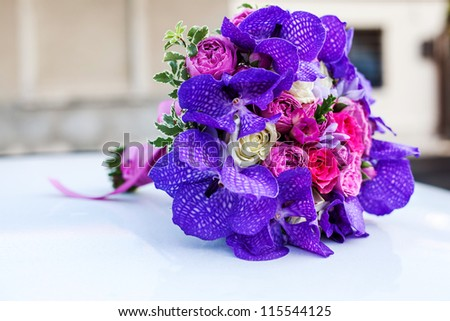 Purple vanda and roses wedding bouquet