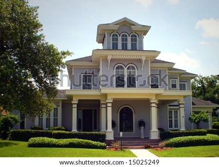 purple victorian upper class american home - stock photo