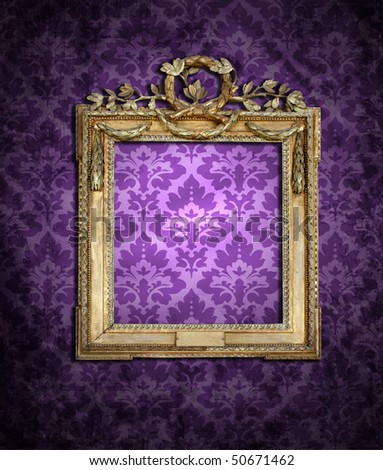 purple wallpaper and dirty empty frame - stock photo