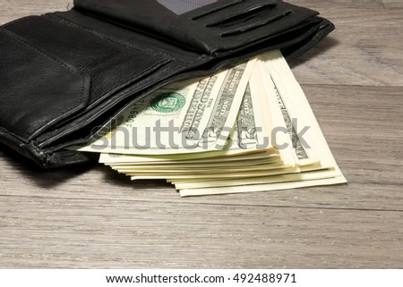 Purse and dollar bills