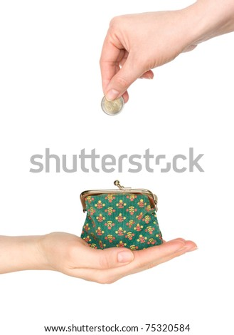 purse in hand and hand put coin in it isolated on white - stock photo